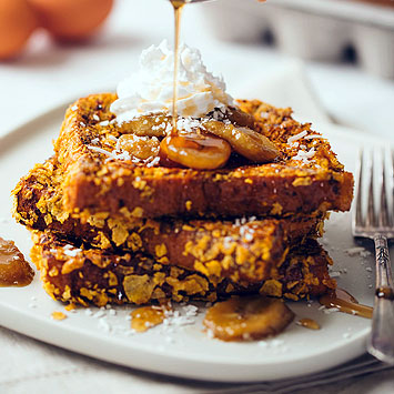 Crispy French Toast with Brown Sugar Bananas, Coconut & Whipped Cream